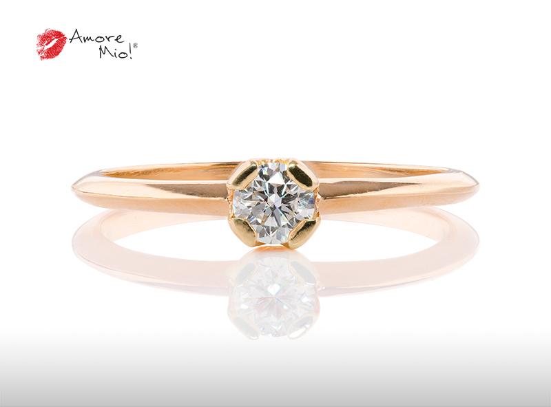 Anillo de compromiso de oro, con diamante central de: 0.24 Puntos Color- D Claridad- VS1  (27/73)