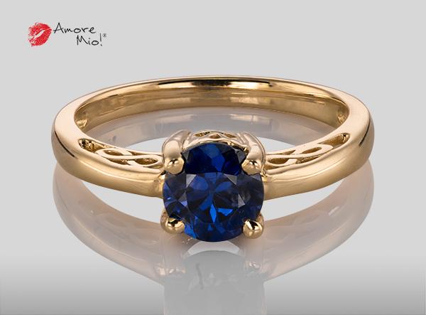 Anillo de compromiso de oro de 14k, con diamante central de:  0.70 puntos color- G claridad- SI1
