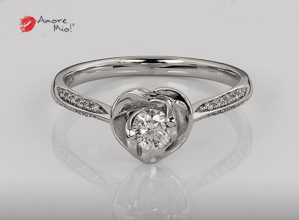 Anillo de compromiso de oro blanco de 18k con un diamante de: 0.23 puntos Color- H Claridad- SI3 (69/31)