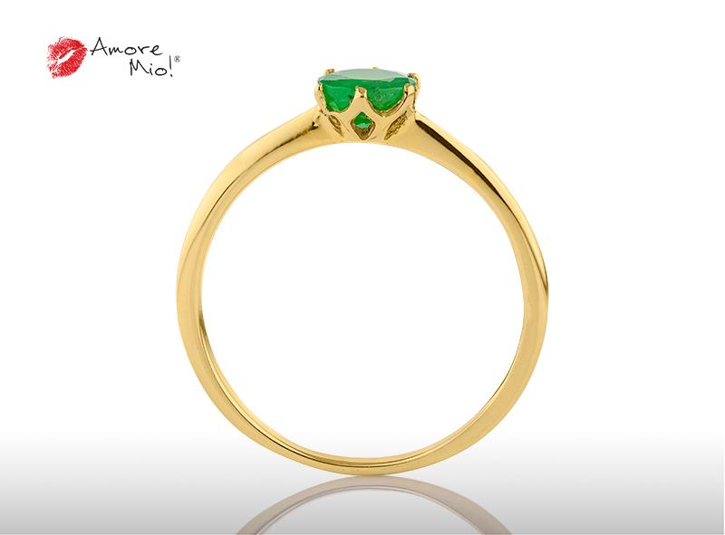 Anillo de compromiso de oro, con Emerald central de: 0.44 Puntos Color- N/A Claridad- N/A