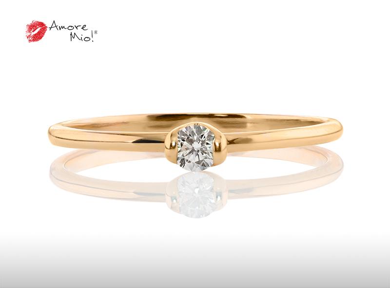 Anillo de compromiso de oro, con diamante central de: 0.12 Puntos Color- F Claridad- SI1 (39/61)