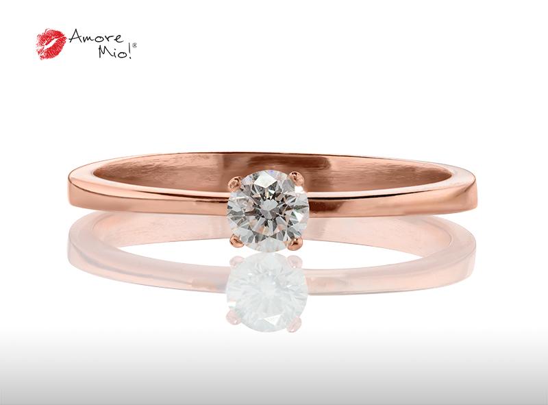 Anillo de compromiso de oro, con diamante central de: 0.08 Puntos Color- F Claridad- VS1  (56/44)