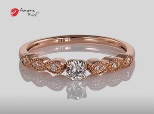 Anillo de compromiso de oro, con diamante central de: 0.10 Puntos Color- G Claridad- VS2