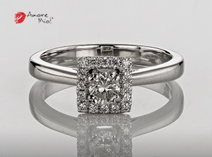 Anillo de compromiso de oro, con diamante central de: 0.22 Puntos Color- H Claridad- SI1 (85/15)