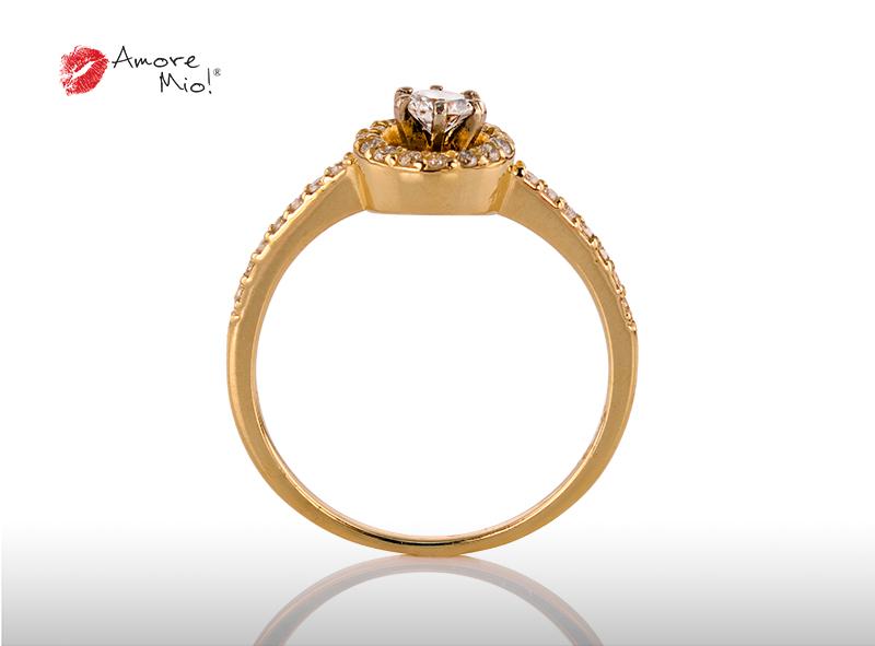 Anillo de compromiso de oro, con diamante central de: 0.18 Puntos Color- D Claridad- VS1 (71/29)
