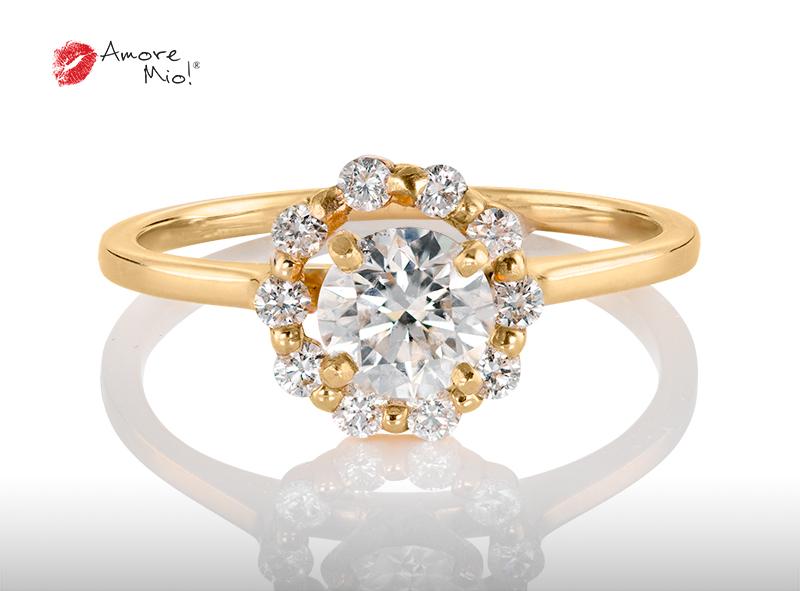 Anillo de compromiso de oro de 14k, con diamante central de:  0.63 puntos color- G claridad- VS1
