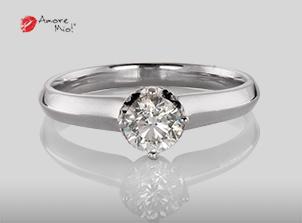 Anillo de compromiso de oro de 18k, con diamante central de:  0.52 Puntos Color- G Claridad- SI1