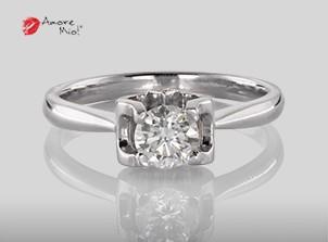 Anillo de compromiso de oro de 18k, con diamante central de:  0.48 Puntos Color- G Claridad- SI1