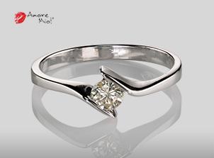 Anillo de compromiso de oro, con diamante central de: 0.22 Puntos Color- I Claridad- VS2