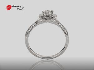 Anillo de compromiso de oro blanco de 18k con un diamante de: 0.23 puntos Color- H Claridad- SI3