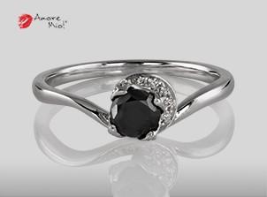 Anillo de compromiso de oro blanco de 18k con un diamante de: 0.42 puntos Color- Black Claridad- N/A (71/29)
