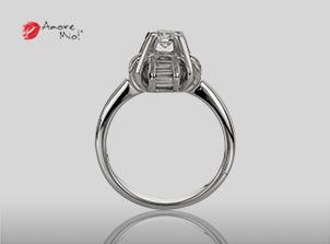 Anillo de compromiso de oro, con diamante central de: 0.23 Puntos Color- D Claridad- SI1 (65/35)