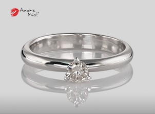 Anillo de compromiso de oro, con diamante central de: 0.23 Puntos Color- I Claridad- SI3 (50/50)